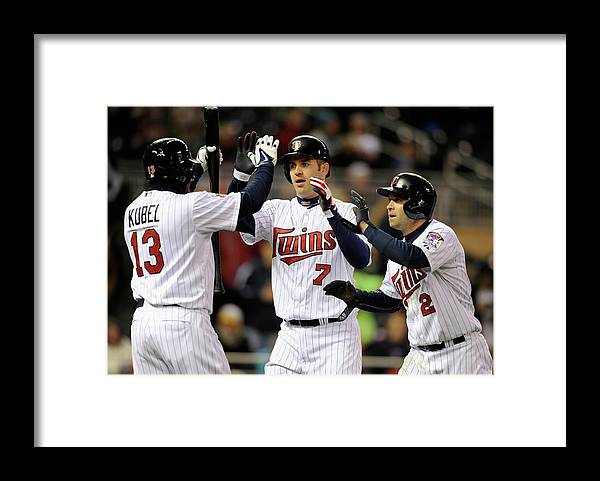 Game Two Framed Print featuring the photograph Joe Mauer, Jason Kubel, and Brian Dozier by Hannah Foslien