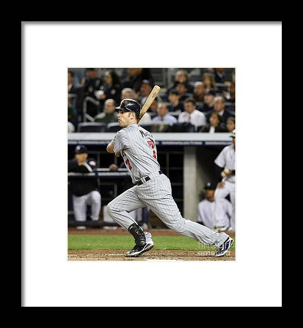 Playoffs Framed Print featuring the photograph Joe Mauer by Nick Laham