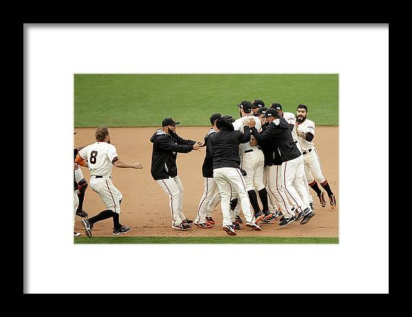 Playoffs Framed Print featuring the photograph Joe Panik and Brandon Belt by Ezra Shaw