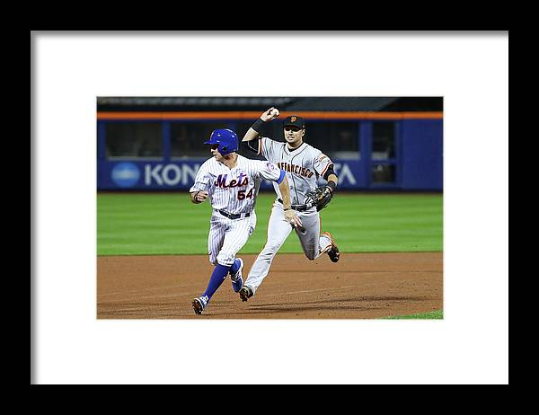 Playoffs Framed Print featuring the photograph Joe Panik and Brandon Crawford by Al Bello