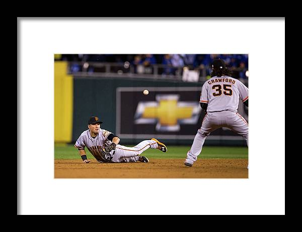 Playoffs Framed Print featuring the photograph Joe Panik And Brandon Crawford by Brad Mangin
