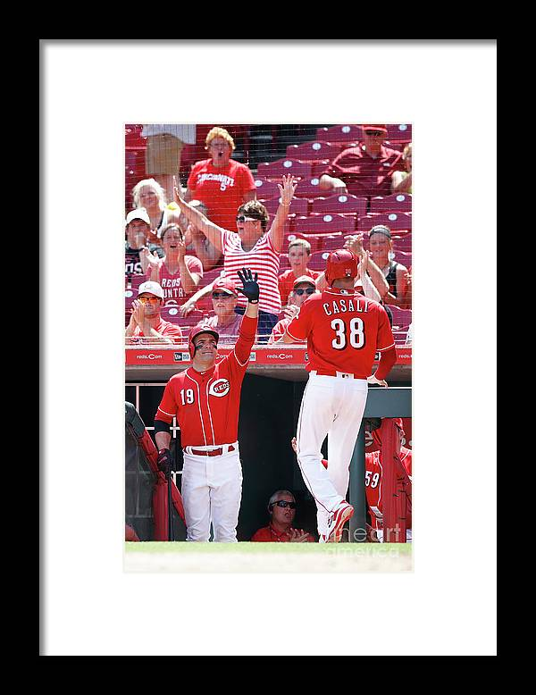 Great American Ball Park Framed Print featuring the photograph Joey Votto and Wade Davis by Joe Robbins