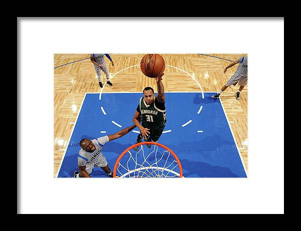Nba Pro Basketball Framed Print featuring the photograph John Henson by Fernando Medina