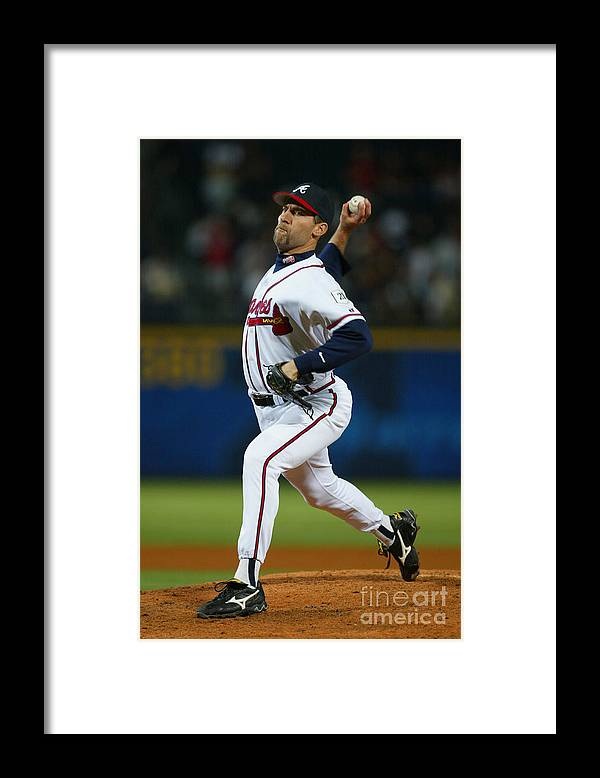 Atlanta Framed Print featuring the photograph John Smoltz by Jamie Squire