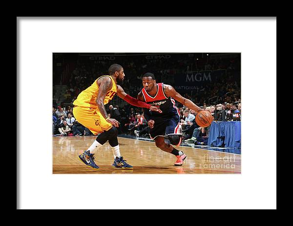 Nba Pro Basketball Framed Print featuring the photograph John Wall and Kyrie Irving by Ned Dishman