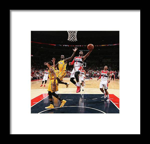 Playoffs Framed Print featuring the photograph John Wall and Lance Stephenson by Ned Dishman