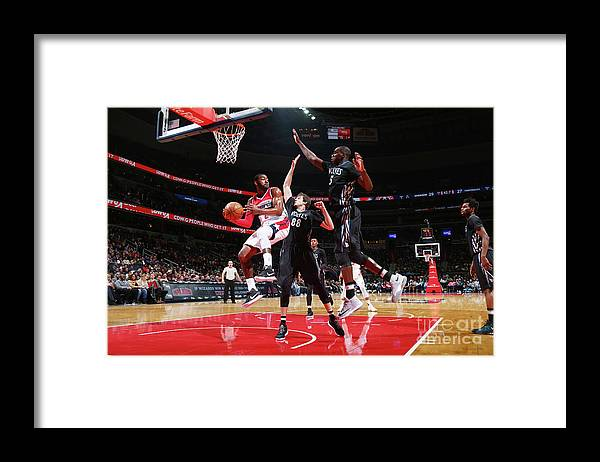 Nba Pro Basketball Framed Print featuring the photograph John Wall, Gorgui Dieng, and Nemanja Bjelica by Ned Dishman