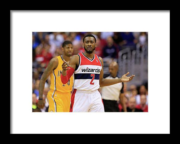 Playoffs Framed Print featuring the photograph John Wall by Rob Carr