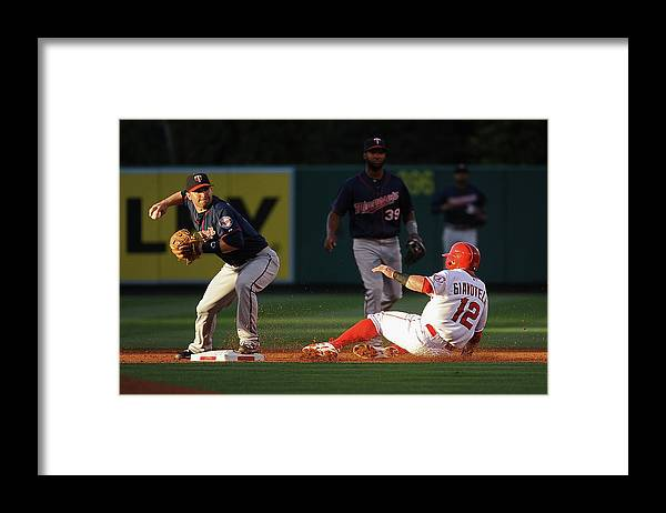 People Framed Print featuring the photograph Johnny Giavotella and Brian Dozier by Jonathan Moore