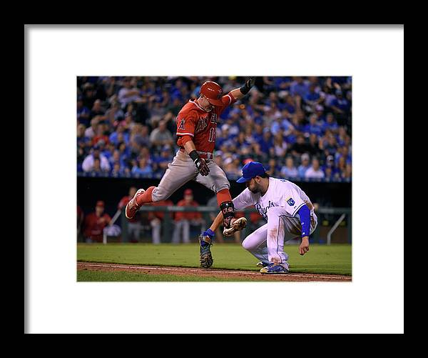 Ninth Inning Framed Print featuring the photograph Johnny Giavotella and Eric Hosmer by Ed Zurga