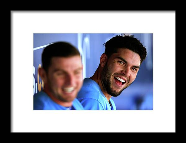American League Baseball Framed Print featuring the photograph Johnny Giavotella and Eric Hosmer by Jamie Squire