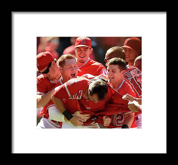 Ninth Inning Framed Print featuring the photograph Johnny Giavotella and Kole Calhoun by Harry How