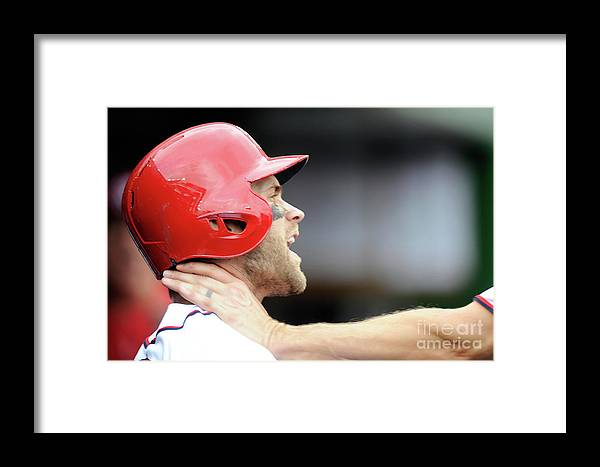 People Framed Print featuring the photograph Jonathan Papelbon And Bryce Harper by Greg Fiume