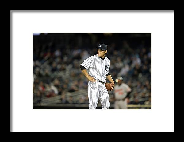 American League Baseball Framed Print featuring the photograph Jonathan Schoop and Masahiro Tanaka by Rob Tringali