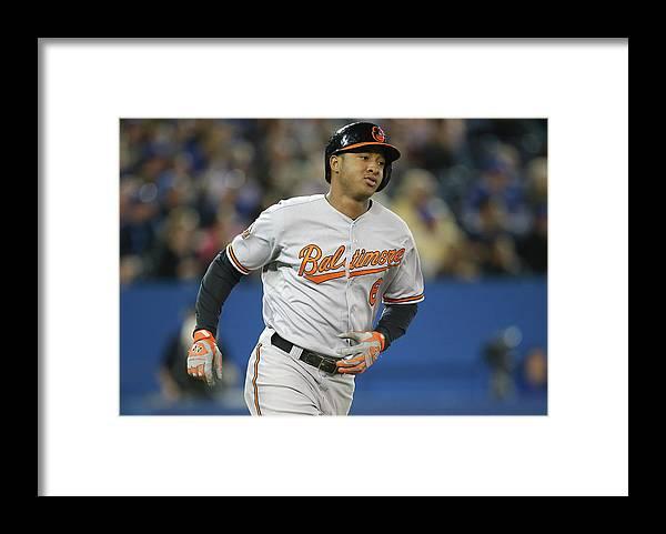 American League Baseball Framed Print featuring the photograph Jonathan Schoop by Tom Szczerbowski