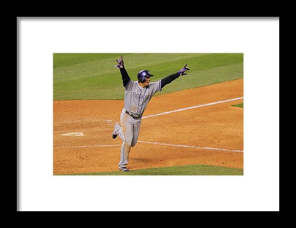 Scoring Framed Print featuring the photograph Jordan Pacheco and Carlos Gonzalez by Doug Pensinger