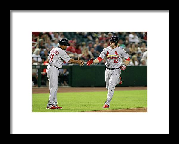 St. Louis Cardinals Framed Print featuring the photograph Jose Oquendo and Mark Reynolds by Ralph Freso