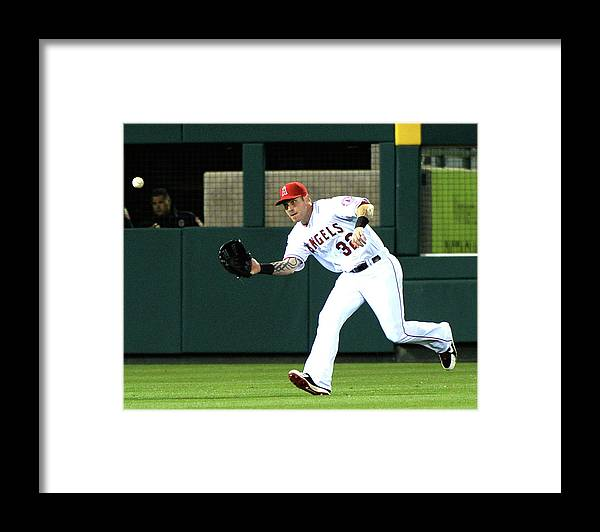 American League Baseball Framed Print featuring the photograph Josh Hamilton and Dustin Ackley by Harry How