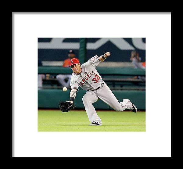 American League Baseball Framed Print featuring the photograph Josh Hamilton and Jason Castro by Bob Levey
