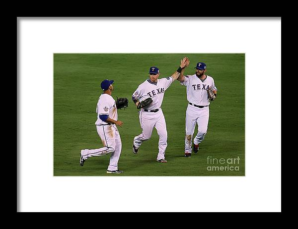 American League Baseball Framed Print featuring the photograph Josh Hamilton, Jeff Francoeur, And Nelson Cruz by Stephen Dunn