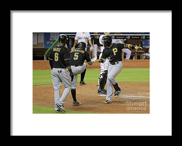 People Framed Print featuring the photograph Josh Harrison, Andrew Mccutchen, and Starling Marte by Mike Ehrmann