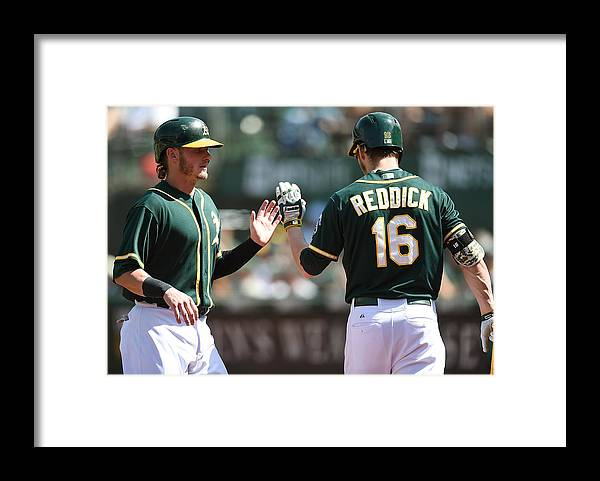 Ninth Inning Framed Print featuring the photograph Josh Reddick and Josh Donaldson by Thearon W. Henderson