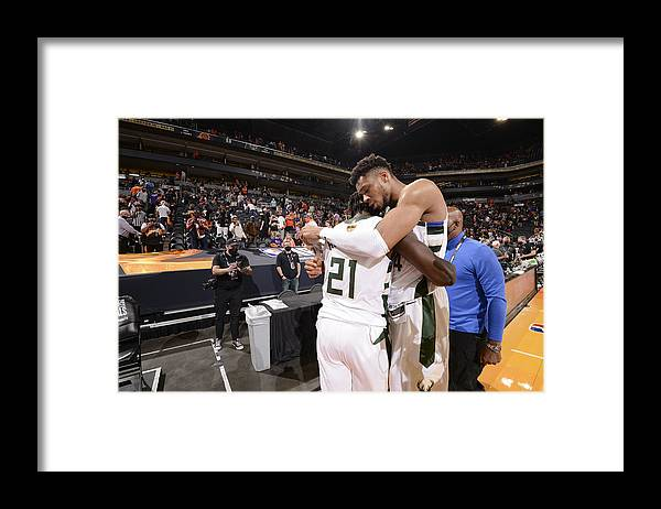 Playoffs Framed Print featuring the photograph Jrue Holiday and Giannis Antetokounmpo by Andrew D. Bernstein