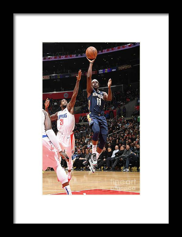 Nba Pro Basketball Framed Print featuring the photograph Jrue Holiday by Andrew D. Bernstein