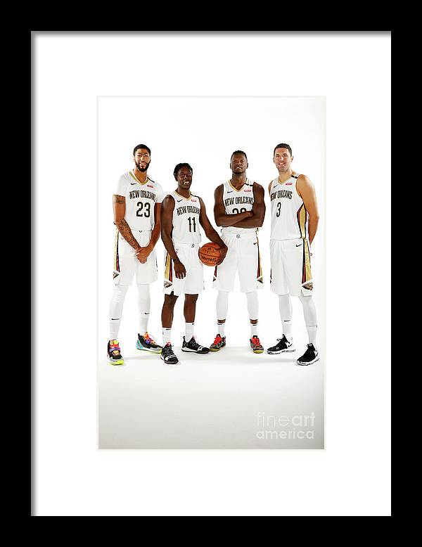 Media Day Framed Print featuring the photograph Jrue Holiday, Anthony Davis, and Julius Randle by Jonathan Bachman