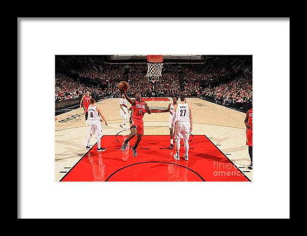 Nba Pro Basketball Framed Print featuring the photograph Jrue Holiday by Cameron Browne