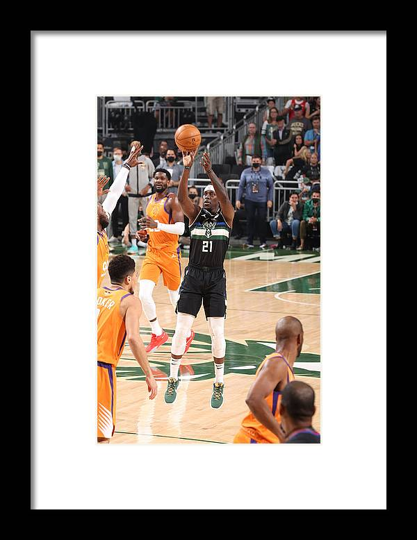 Playoffs Framed Print featuring the photograph Jrue Holiday by David Sherman