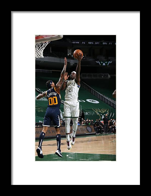 Nba Pro Basketball Framed Print featuring the photograph Jrue Holiday by Gary Dineen