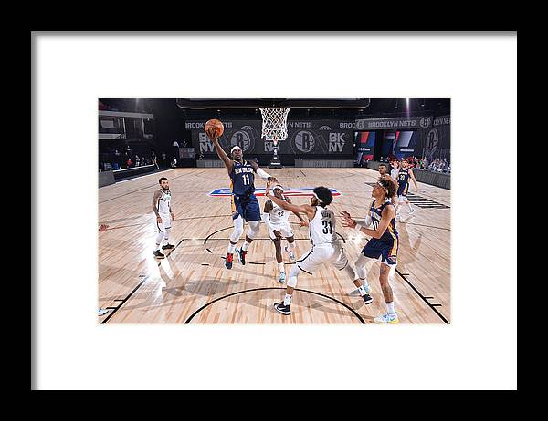 Nba Pro Basketball Framed Print featuring the photograph Jrue Holiday by Jesse D. Garrabrant