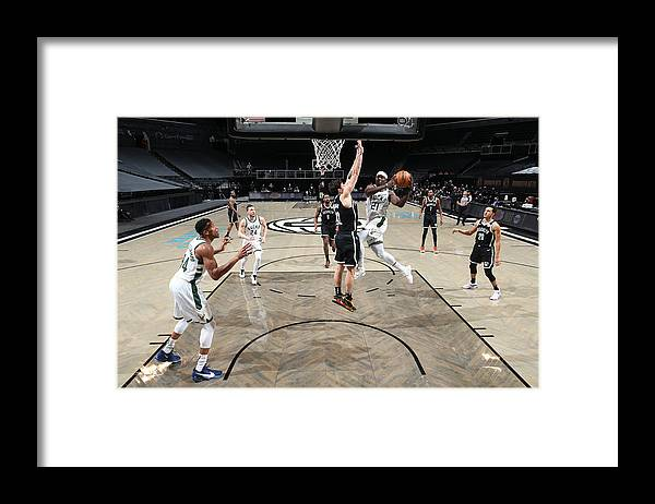 Nba Pro Basketball Framed Print featuring the photograph Jrue Holiday by Nathaniel S. Butler