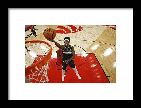 Nba Pro Basketball Framed Print featuring the photograph Jrue Holiday by Scott Audette