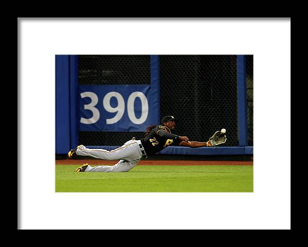 Ball Framed Print featuring the photograph Juan Lagares and Andrew Mccutchen by Jim Mcisaac