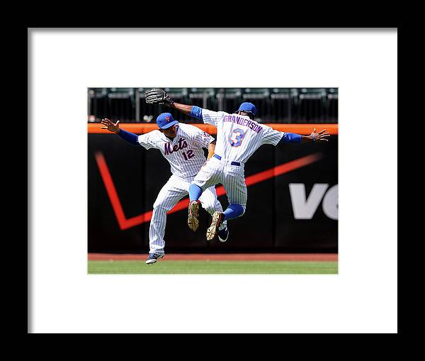 People Framed Print featuring the photograph Juan Lagares and Curtis Granderson by Elsa