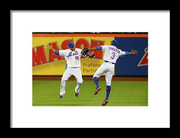 People Framed Print featuring the photograph Juan Lagares and Curtis Granderson by Jim Mcisaac