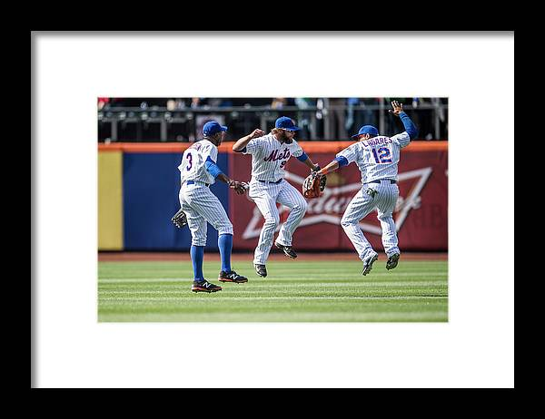 American League Baseball Framed Print featuring the photograph Juan Lagares, Kirk Nieuwenhuis, and Curtis Granderson by Rob Tringali