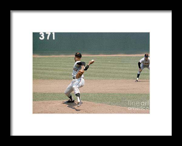 Baseball Pitcher Framed Print featuring the photograph Juan Marichal by Louis Requena