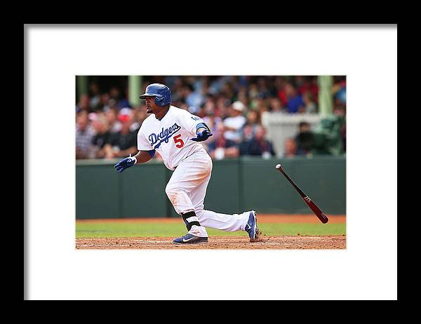 Los Angeles Dodgers Framed Print featuring the photograph Juan Uribe by Brendon Thorne