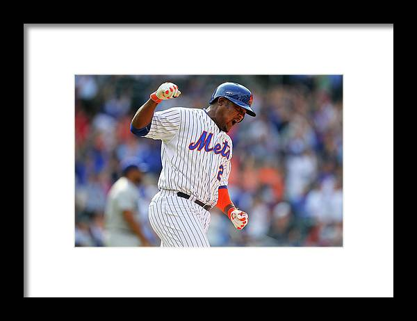 Three Quarter Length Framed Print featuring the photograph Juan Uribe by Mike Stobe