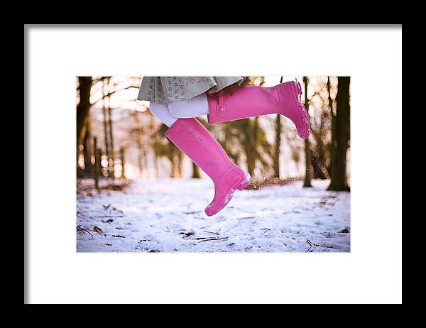 Child Framed Print featuring the photograph Jumping with pink boots by Olivia Bell Photography