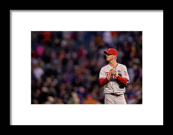 Defeat Framed Print featuring the photograph Justin Morneau And Kyle Kendrick by Justin Edmonds
