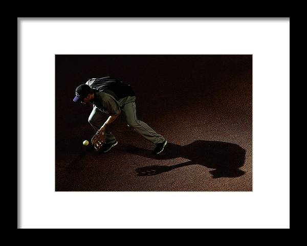 Ball Framed Print featuring the photograph Justin Morneau by Christian Petersen