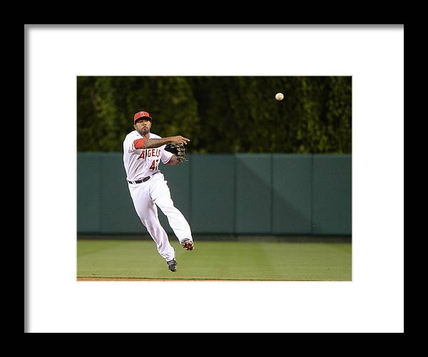 Second Inning Framed Print featuring the photograph Justin Smoak and Howie Kendrick by Harry How