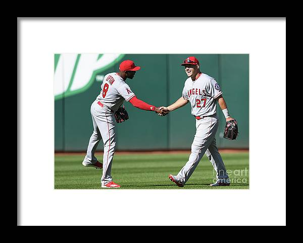 American League Baseball Framed Print featuring the photograph Justin Upton and Mike Trout by Thearon W. Henderson