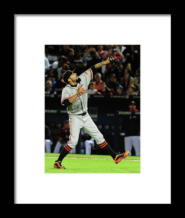 Atlanta Framed Print featuring the photograph Justin Upton and Sergio Romo by Scott Cunningham