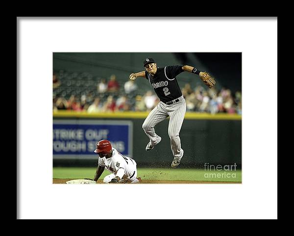 Double Play Framed Print featuring the photograph Justin Upton and Troy Tulowitzki by Christian Petersen
