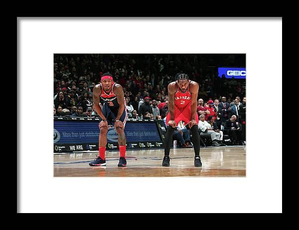 Nba Pro Basketball Framed Print featuring the photograph Kawhi Leonard and Bradley Beal by Ned Dishman